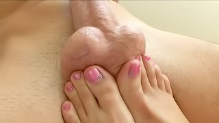 Girls sexy feet are working their magic on a cock and two balls