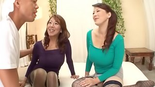 Kinky Asian cougar with massive tits enjoying a hardcore threesome