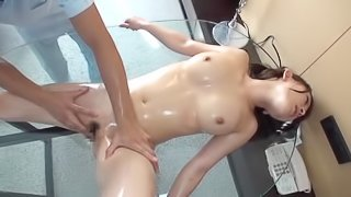 Lovely Japanese brunette gets oiled massaged then fingered hardcore